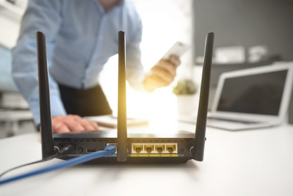 man boosting speed of wifi router